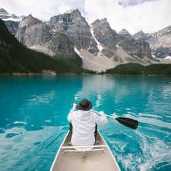 Canoeing in the glacier-fed water of Moraine Lake