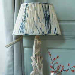 Samarkand Design 45cm Shibori Pushkar silk lampshade, £195, and wood and gesso Indian Scroll lamp base, £175
