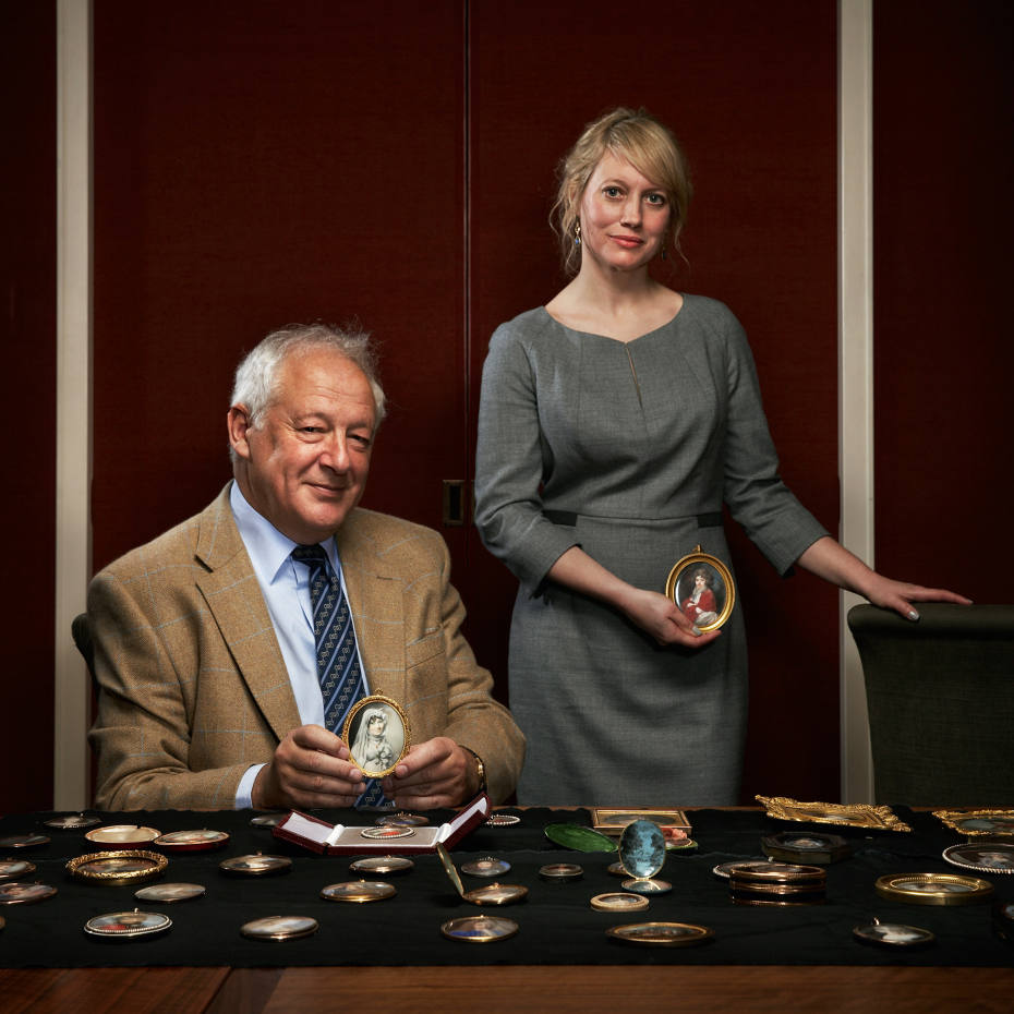 Robert Harman and Emma Rutherford at the Philip Mould & Co gallery in London, holding miniatures by George Engleheart and Augustin Ritt