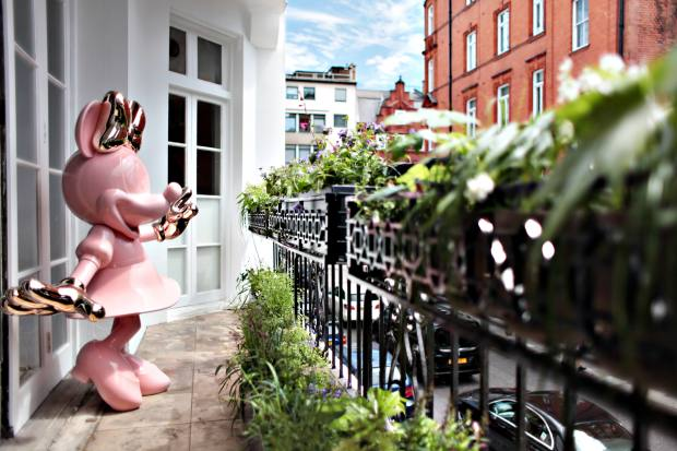 Urban Retreat's mascot: a pink Minnie Mouse on the building's Kensington balcony