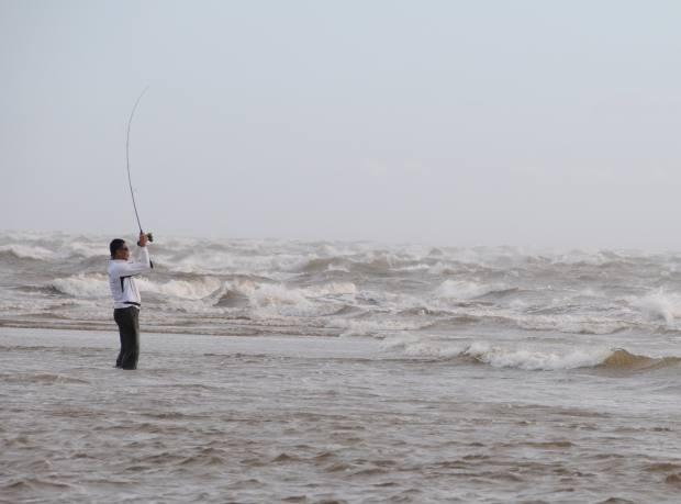 Tong casts into the surf near Kawar camp