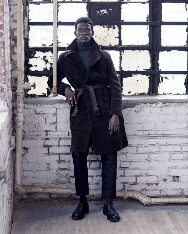 Bottega Veneta lamb shearling coat, £5,240, and cotton gabardine trousers, £605. Hermès extra-fine cashmere rollneck, £1,100. Falke cashmere socks, £60. Saint Laurent by Anthony Vaccarello leather Derby shoes, £600