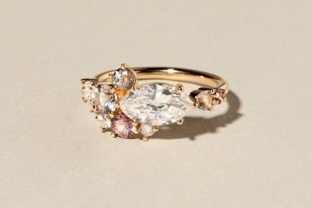 Mociun gold ring with diamonds, kaleidoscope Montana sapphires and spinels