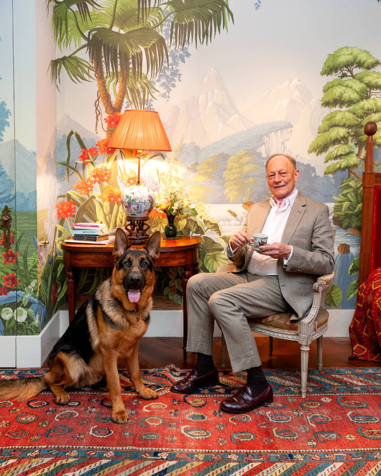 Claud Cecil Gurney with Mowgli, his German Shepherd, at home in London