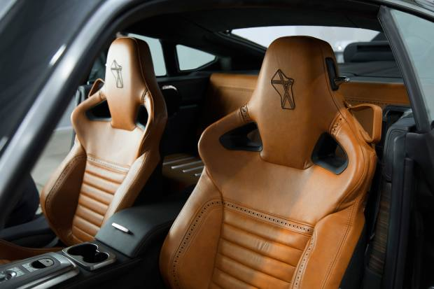 Its interior seats finished with brogued and embroidered antique leathers