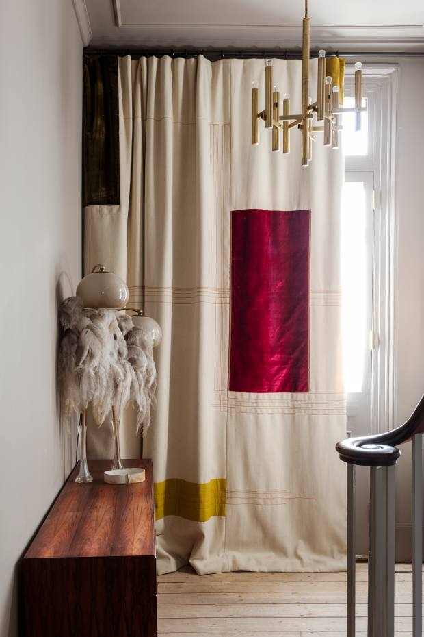 Nest's bespoke creations include antique silk patchwork curtains and double-height draperies containing swatches of velvet