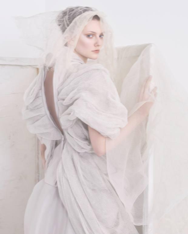 Rick Owens linen/cotton top, £1,535, and silk skirt, £1,856. Veil, stylist's own