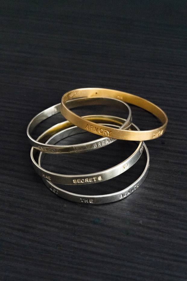 Gold and silver engraved bracelets given to Berry by her parents