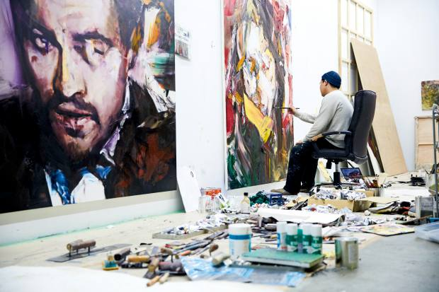 Yukimasa Ida at work on one of his celebrated oil portraits