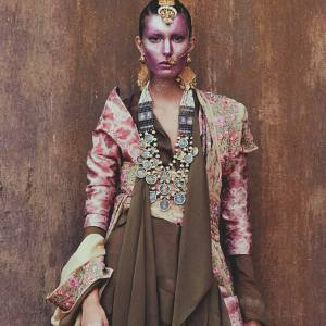 Aganovich silk-mix jacket, £720, matching trousers, £1,116, and silk-mix and leather boots, £930. Chloé silk dress, £1,900. Pratap Sons silk georgette sari, £136. Amrapali yellow gold jewelled hairpiece with diamonds, rubies and emeralds, £100,500, yellow gold nose ring with diamonds and emeralds, £2,700, yellow gold ethnic chandelier earrings with rubies, £5,700, silver necklace with mythological paintings, £1,991, and yellow gold cuff with Basra pearls (just seen), £35,900