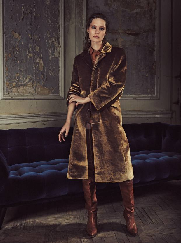Vetements velvet coat and calfskin boots, both price on request. Tod's cotton shirt, £530. Louis Vuitton gold finish brass Wish Bone earrings, £450 for pair. Ana Khouri gold Mirian ring, £1,900. Roche Bobois velvet Profile sofa by Roberto Tapinassi and Maurizio Manzoni, from £3,330