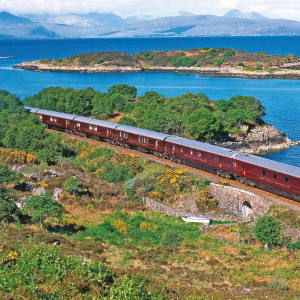 The Royal Scotsman travels through loch and mountain scenery