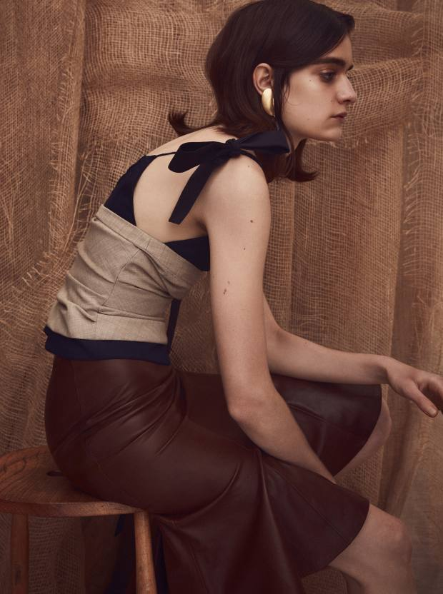 Jacquemus wool bustier top, £413. Salvatore Ferragamo leather skirt, £1,615. Slim Barrett gold plated silver and fabric tassel earring, £390 for pair