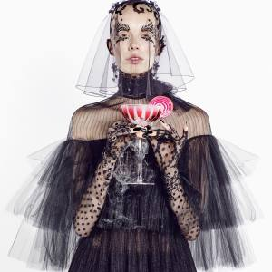 Valentino silk tulle dress, £4,335. Stephen Jones Millinery tulle I'll Be There veil, £345. Gloves, stylist's own William Yeoward handmade crystal Vita Tall Coupe cocktail glass, £150