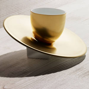JL Coquet gold-coloured Slider egg cup (platinum-coloured also available and white with a platinum-coloured rim), £98