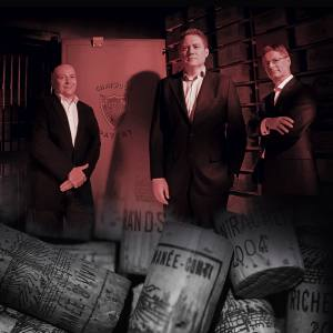 67 Pall Mall founder and CEO Grant Ashton (centre) with head of wines Ronan Sayburn (left) and general manager Niels Sherry (right) in the vaults