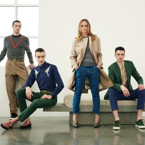 Stella McCartney with models wearing items from her debut menswear collection. From left: cotton jumper, £570, cotton trousers, £320, canvas trainers, £315, and elastic belt, £180; cotton shirt, £485, cotton trousers, £325, canvas shoes, £290, and elastic belt, £180; and cotton jacket, £840, cotton shirt, £345, cotton trousers, £325, and canvas trainers, £315