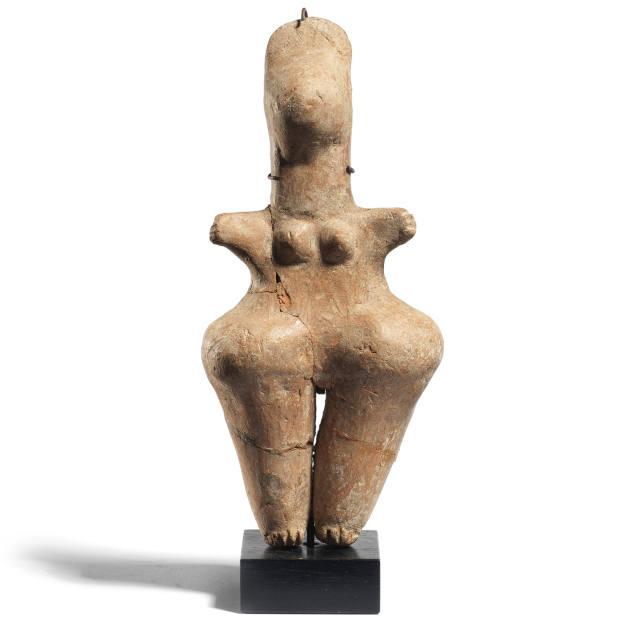 An Amlash terracotta figure displaying steatopygia, £2,000-£3,000