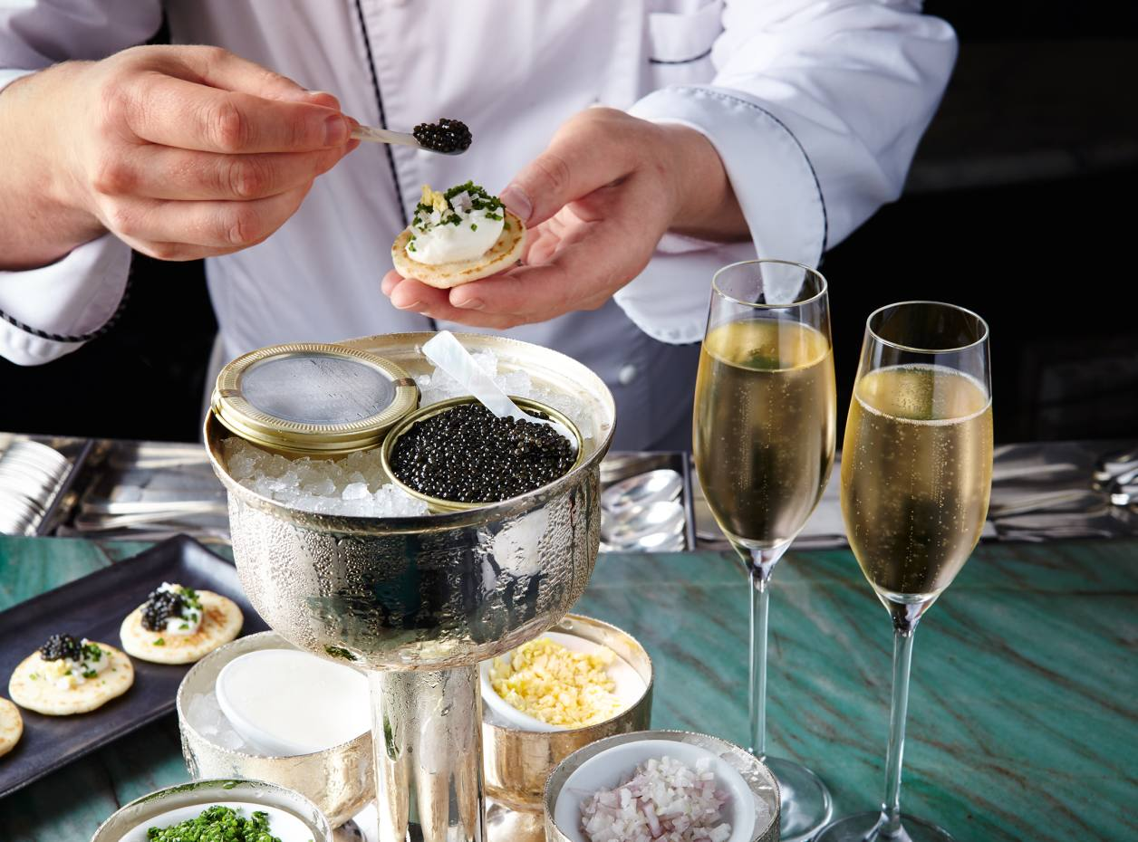 Caviar blinis being prepared at Kaspar's Seafood Bar & Grill, The Savoy