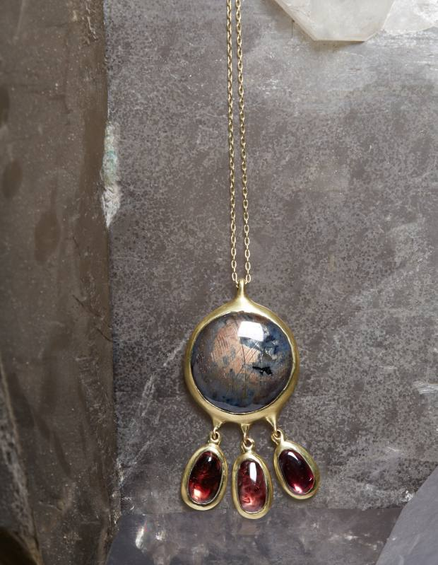 Gold, sapphire and garnet Peacock necklace, $17,540