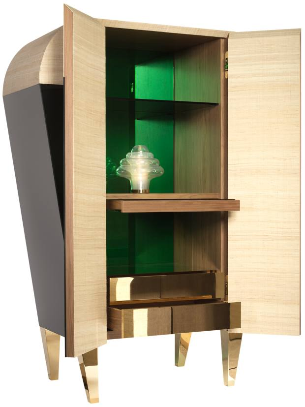 Behind the cabinet's reflective black glass front lies a mirrored emerald interior