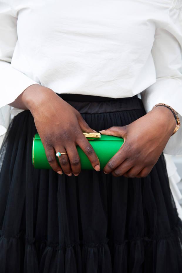 Amanda Pearl duchesse-satin clutch bag, $575, and enamel and pearl ring, $122