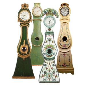 From left: 1800s Mora clock, sold for £4,200; 1800s clock, £1,600; 1700s bridal clock, sold for £6,000. All from Gustavian. 1820-1850 trompe‑l'oeil clock, £3,950 from Swedish Interior Design