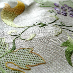The Les Vignes table linen – which captures the beauty of a vineyard changing seasons – requires hours of intricate hand-embroidery