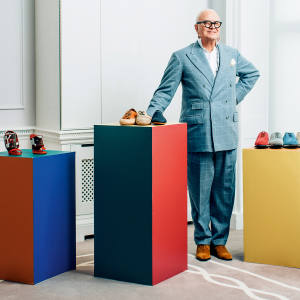 Manolo Blahnik in his London showroom with an array of his men's shoes. From left: raffia shoes, all price on request, and suede Entrenador shoes, £595 each