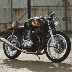The artist's original project, completed in 2012 and named First Born, started life as a 1978 Honda CB550 and now takes the form of a classic-looking café racer with a red, black and gold paint job
