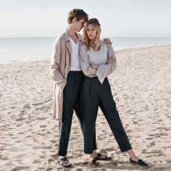 He wears Giorgio Armani linen coat, £1,150. Ermenegildo Zegna Couture cotton T-shirt, £420. Paul Smith mohair/wool trousers, £355. Michael Kors Collection leather Dominick sandals, £181. She wears Bottega Veneta cotton top, £385, and calfskin shoes, £545. Margaret Howell silk taffeta shirt, £345, and linen trousers, £335