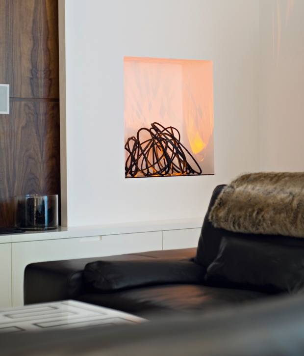 Cathy Azria for BD Design's steel and LED‑light Loop fire, £4,200, creates the effect of fire without the heat