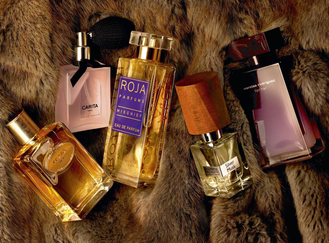 From far left: Prada Infusion d'Iris Absolue, £59.50 for 50ml. Carita Eau de Parfum, £65 for 50ml. Roja Parfums Mischief, £195 for 100ml. Nasomatto Silver Musk, £108 for 30ml. Narciso Rodriguez For Her Eau Délicate Eau de Toilette, £49 for 50ml. Background: fur Crater jacket, £3,945, from www.hockley.com.