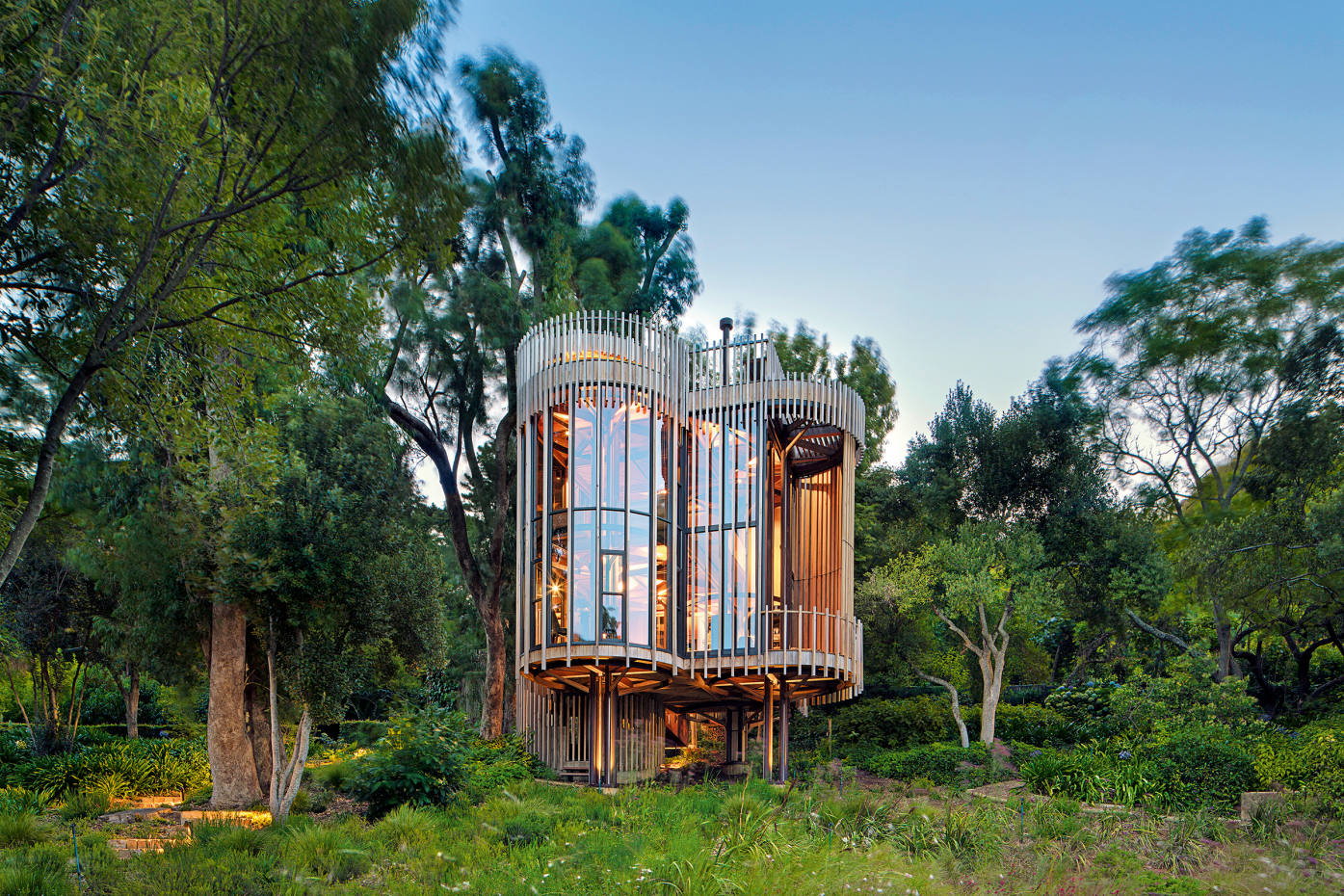 A treehouse-like residence in South Africa's Constantia Winelands, designed by architect Pieter Malan of Malan Vorster and formed from a collection of elevated cylinders
