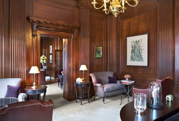 The club rooms feature walnut panelling, chandeliers, leather and velvet