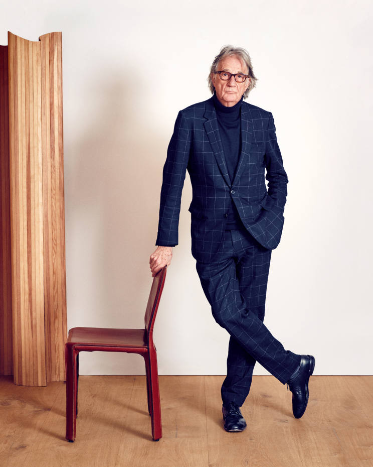Paul Smith with one ofhisMario Bellini-designed 412 CAB chairs
