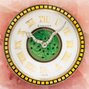 Pink-quartz Cartier clock by Maurice Coüet, c1925, with mother-of-pearl dial, carved jade centre and onyx handle, estimate CHF40,000-60,000, at Christie's