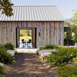 A barn by Walker Warner Architects in California's Portola Valley has been turned into an office, media room and guest suite