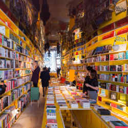Libreria's colourful interior, with its undulating shelves and mirrored ceiling