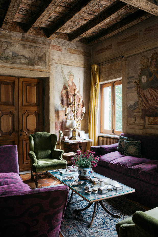 Timber beams and supports are covered in rich botanical and scroll motifs