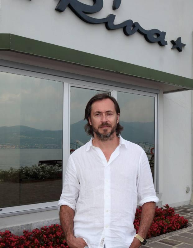The designer at the Riva boatyard.