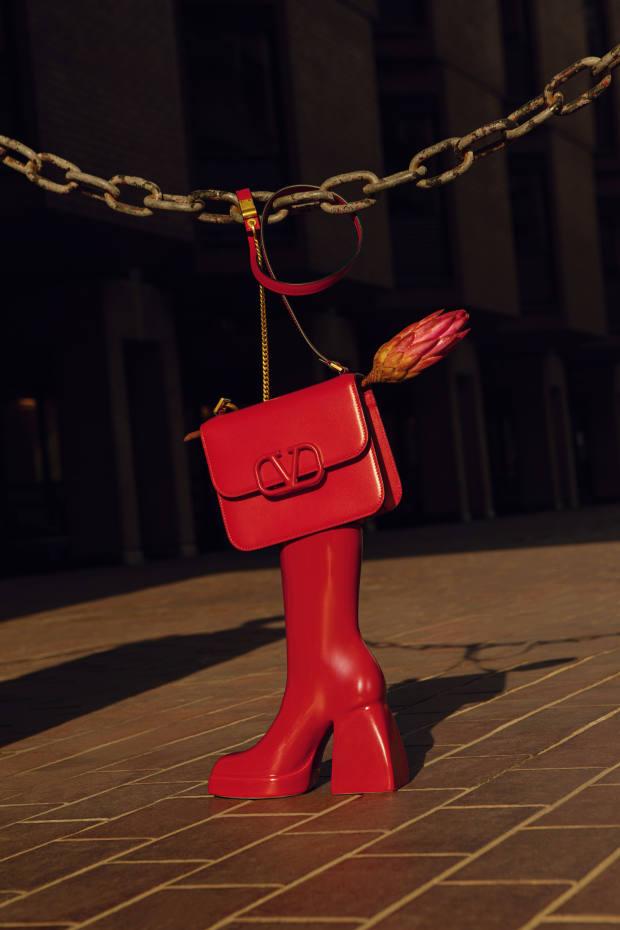 Valentino Garavani leather Vsling bag, £1,635. Anissa Kermiche x Nodaleto ceramic BullaCorta Boot vase, £200