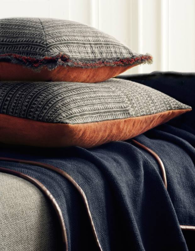De Le Cuona wool/linen fringed Expedition cushion in Kilimanjaro, £190, unfringed version, £180, and Sebastian Arabica linen and leather throw, £570