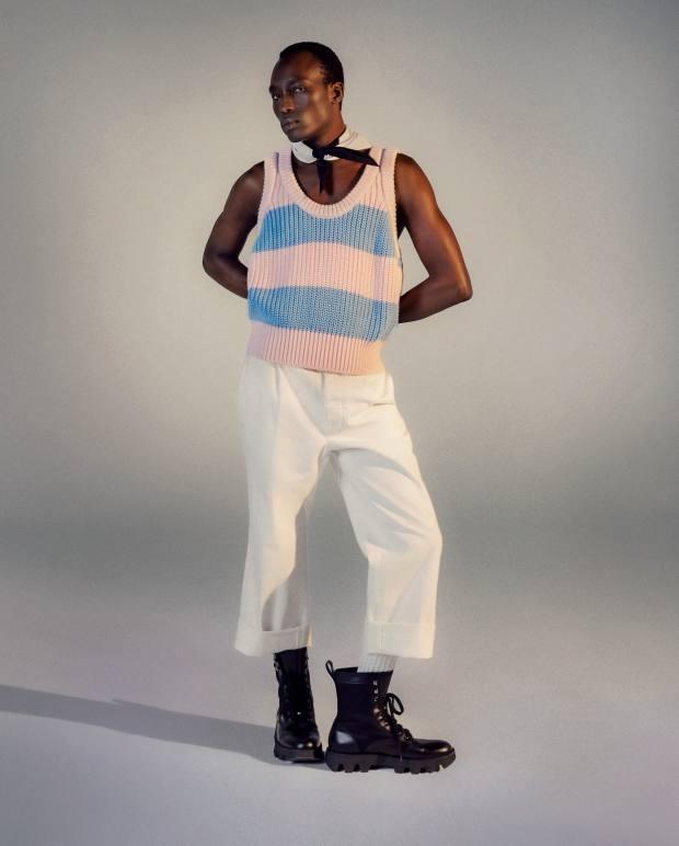 Prada cotton knit top, £605, denim trousers, £545, Oxford cotton foulard, £120, cotton socks, £140, and leather/nylon Rocksand boots, £740