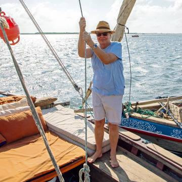Nicholas Logsdail aboard the dhow he rents in Lamu