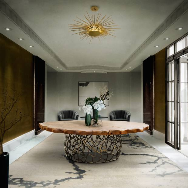 Brabbu brass Soleil pendant light, €3,040, and oak and brass Apis dining table, €27,530