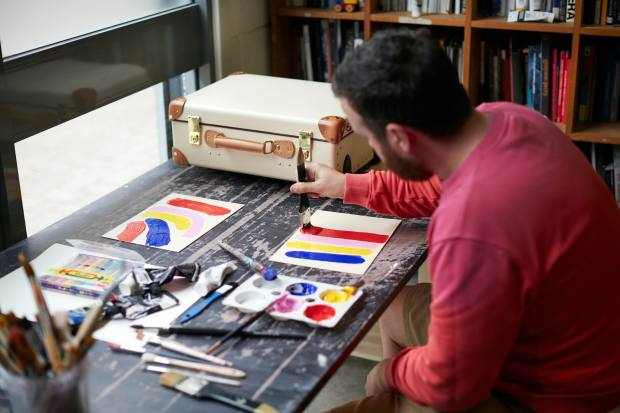 John Booth working on designs in his studio