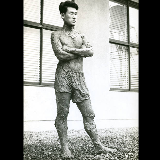 Kazuo Shiraga during one of his Challenging Mud performances, 1955