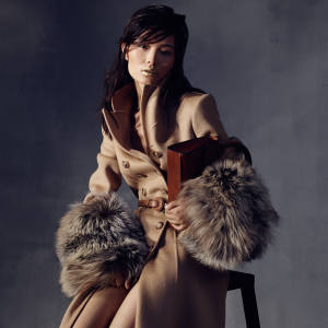 Ling wears Michael Kors Collection double face wool and fox fur princess coat, £3,620, calfskin belt, £260, and burnished leather Harlington satchel, £565
