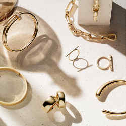 Clockwise from bottom left: Jacqueline Rabun gold Mercy torque, £8,500. Cassandra Goad gold Onda ring, £1,890, and Onda Unico cuff, £5,225. Chaumet gold and diamond Escapade bracelet, £54,500. Tiffany & Co gold City HardWear necklace, £8,875. Belmacz gold Tevas bangle, £17,800. Sean Gilson gold Ovoid earrings, $4,400. Belmacz gold Odom ring, £11,600. Vhernier rose-gold Eclisse ring, £5,200. Hannah Martin gold, rose-gold and diamond Possession ring, £6,450. Props: Salvatori Omaggio a morandi bottle, €324, from pamono.com. Dale Rogers ammonite fossil-wood sphere, £300, from dalerogersammonite.com